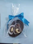 Easter half hollow egg with four chocolates with nuts